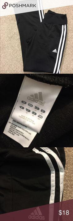 """Adidas workout joggers (Sz Sm) Great pair of Adidas black jogging pants. Excellent shape except one small place I showed in pic . I think it's like blue nail polish. It looks bad in pic because I zoomed in on it. You can't hardly even notice it when you have them on. Less than a 1/4 """" on little spots. Measures 24"""" waist. 30.5"""" leg inseam length. Straight leg side pockets in front. 🤗 fabric 100% poly Adidas Pants Track Pants & Joggers"""