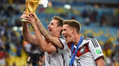Miroslav Klose and Erik Durm of Germany celebrate with the World Cup trophy