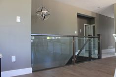 Clear Tempered glass stair railing with Brushed Nickel clamps grandrivergla. - house and flat decorations Staircase Banister Ideas, Interior Stair Railing, Modern Staircase, Staircases, Banister Remodel, Glass Stairs, Glass Railing, Basement Stairs, House Stairs