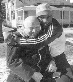 A young Mike Tyson with his famous trainer Cus D'Amato. He saw the lion and greatness in Tyson first. If he had lived longer he may have guided Tyson to even more greatness. Besides Tyson Cus D'Amato also trained Floyd Patterson