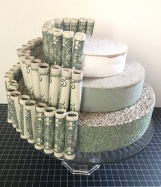Cake stand + Styrofoam discs + rolled bills secured with clear plastic bands sec. Cake stand + Styrofoam discs + rolled bills secured with clear plastic bands secured to foam via straight pins. Graduation Decorations, Graduation Party Decor, Grad Parties, Graduation Ideas, Graduation Desserts, Graduation Celebration, College Graduation Cakes, Graduation Party Centerpieces, 8th Grade Graduation
