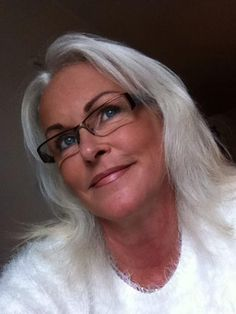 Of course I love to see images of older women with 1)long hair, and 2) glasses. But . . . glasses. We have not been in the midst of a very kind trend. These severe, rectangular glasses -- the cyborg look -- look good on some people. They don't do too many favors for those of us with smaller features and long faces, who need some curve and softness. I'm missing the tiny oval glasses trend, though now the really tinies won't work with my bifocals. And the Big Glasses? No. Go away, 7th grade.
