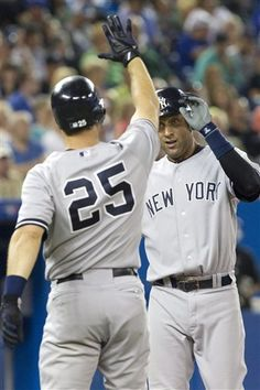 GAME 112: Friday, Aug. 10, 2012 - New York Yankees' Derek Jeter, right, celebrates with teammate Mark Teixeira after scoring during the ninth inning against the Toronto Blue Jays in a baseball game in Toronto