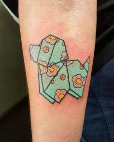 Origami dog tattoo