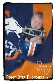 i dont think i've ever seen this one before.  newborn in football team helmet