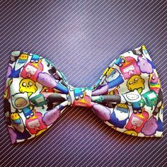 http://www.etsy.com/listing/155405842/adventure-time-print-handmade-fabric-bow