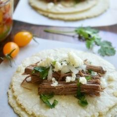 Pop a brisket and a bottle of beer in the crock pot in the morning and have these easy Beef Brisket Tacos for dinner