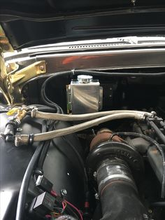 I installed a coolant overflow tank and braided stainless heater lines and the shutoff to the heater core for the summer months.