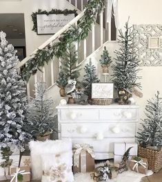 There's no place you can't add Christmas touches in your home. Annette from @cherished_treasures_ has created a clever vignette beaneath the stairs with a simple dresser and lots of Christmas trees and presents #americanfarmhousestyle #farmhouse #farmhouseaesthetic #farmhousestyle #livinginthecountry #christmasdecor #christmasdecorating #countrychristmas #farmhousechristmas #christmastree #christmaspresents