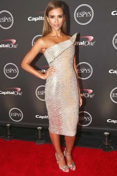 Jessica Alba is wearing a couture dress by Elie Saab