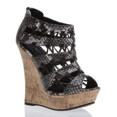 """the """"drinna"""" from ShoeDazzle: faux snakeskin black/grey strappy bootie stands 5. 5"""" on the cork wedge heel. LOVELY!"""