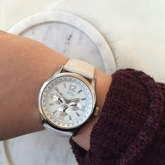 Guess white leather watch Guess white leather watch. Purchased from guess three years ago. Has been worn and does have a little discoloration on the strap. It does need a new battery. Needs a new home! Guess Accessories Watches
