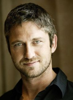 Gerard Butler - great smile but not often photographed with one