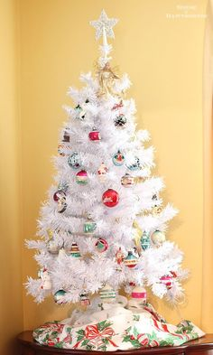 Vintage Shiny Brite ornaments on white Christmas tree. More ways to display…