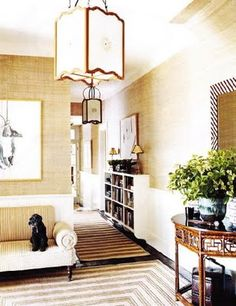 Grasscloth foyer with lanterns and bamboo demi-lune
