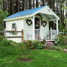 Cottage-Style Garden Shed        Painted crisp white, this cottage-style potting shed features a cozy front porch and beautiful flower-flanked stone walkway. Stained lattice hides the footings beneath the porch. A salvaged, natural multipaned entry door allows light inside the shed. Solar-powered pendant lights shine the way after dusk.