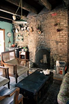 Lounge - old brick wall & fireplace. I just love the look of it. So rustic!