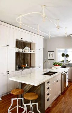"""Sarah Richardson-designed kitchen using IKEA cabinets -- love the wall of cabinets using 12"""" deep upper cabinets stacked"""