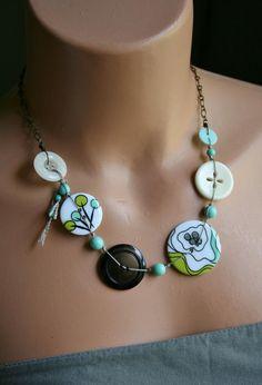 Button necklace. Decoupage pattern paper, like a map, onto plain button