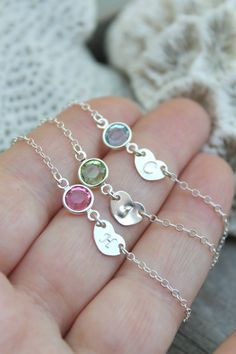 This necklace is made for a little girl! Personalized sterling silver necklace with one sweet initial heart tag and one Swarovski Birthstone charm.