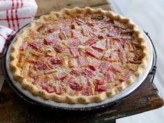 Rhubarb Custard Pie: There are many varieties of rhubarb which account for how the stalks vary in color from a deep red to a pale green. Although the flavor is delicious for all kinds, this pie looks prettiest with the red-stalked varieties. Look for thinner stalks, they will be more tender and less fibrous than thicker stalks.