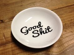 You are looking at a custom Good Shit ceramic trinket dish or ring holder! Your Good Shit text can be in any of the colors shown in the color chart and is made from a glossy high-quality vinyl rated for outdoor use. Choose your color at checkout!  Round ceramic dish measures roughly 4 across the widest part (the top).  Perfect for wedding rings, earrings, keys, treasures, etc. These make a great gift for engagements, birthdays, anniversaries, weddings, and more! Great for men!  Thank you so…