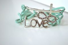 Etsy - aqua rhinestone cross bracelet - Pretty color