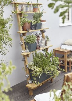 Create and display with your pots by using steps or a shelving unit. Perfect for smaller gardens.