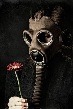 This mask is sewn to my flesh so I cannot alas smell the last flower to bloom in my personal Hell.