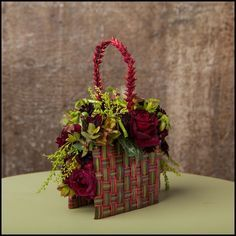 Botanical purse with woven draecena leaves | Francoise Weeks - photo by Ted Mishima