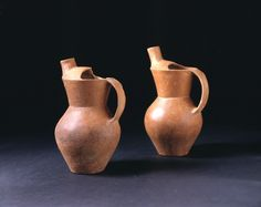 A Pair of Neolithic Red Pottery Ewers. Qijia Culture, China