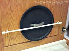 Use a curtain rod and 2 cup hooks on your cabinet door to hold pan lids. - Loving this for putting curtains instead of doors on my cabinet fronts. It will be closer to the cabinet this way.