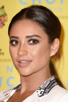 Shay Mitchell is fresh-faced with neutral makeup and a touch of eyeshadow