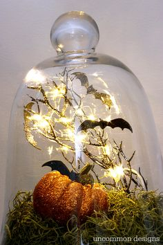 Make a gorgeous Halloween cloche with a few basic crafting supplies! with Uncommon Designs