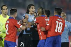 Cavani makes his disagreement very clear as he argues with formerWest Bromwich Albion defender Jara over his reaction to the touch. Copa America Chile 24.6.15 Uruguay vs Chile