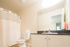 Personal bathrooms with granite vanity counter-tops, and curved shower rods to provide extra space!