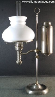 This Manhattan student lamp is complete with an original, opal glass shade. It was made by the Manhattan Brass Company and has patent dates of 1877 and 1879