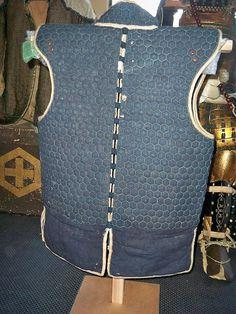 Antique Japanese (samurai) kikko manchira. An armored vest worn underneath armor made from small hexagon armor pieces kikko sewn between layers of cloth.