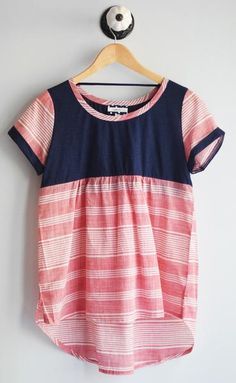 Red and Navy short sleeve top with color block contrast. Hi-low style. 100% cotton handwash