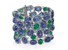 Rina Limor, 18-karat white gold wide bracelet with cabochon tanzanite, cabochon emeralds and diamonds