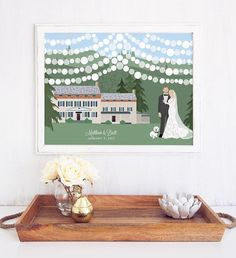 Our Wedding Guest Book with Couple Portrait, Mountain Estate Venue Illustration, and Sign In Lanterns features a custom illustration of the couple standing in front of their wedding venue with strings of lanterns hanging above for guests to sign.