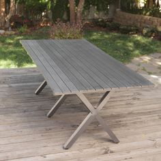 Bella All Weather Resin Patio Dining Table $499.98  Would look great with wicker dining chairs and bench seats