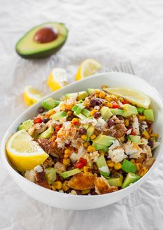 These spicy fish taco bowls are comfort food at its finest with a healthier twist. Fresh blackened spicy tilapia fillets, corn, black beans, red peppers and avocados make this dish a hearty, filling and most delicious lunch or dinner without the guilt.  #healthyeating #fish #tilapia