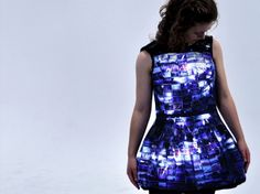 Little Recycled Slides Dress lights up.  New Zealand designer, Emily Steel has taken the classic LBD and given it a high-tech, film-inspired upgrade. Steel adhered slide film to the dress along with LED lights, which light up to reveal the images.