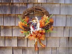 Scarecrow Wreath Scarecrow Wreath, Fall Plaid, Oak Leaves, Ribbon Bows, Pine Cones, Grapevine Wreath, Grape Vines, Wreaths, Crafts