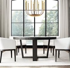 """RH Modern's Quenouilles Round Chandelier 24"""":Created by renowned lighting designer Jonathan Browning, this fixture has the presence of modern sculpture. Mid-century in inspiration, delicate arms evoking organic forms culminate in Edison-style bulbs."""
