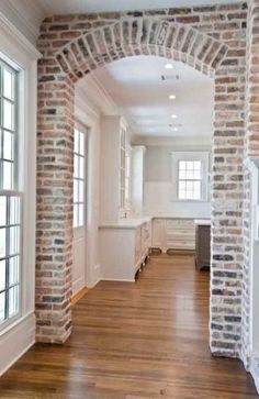 An exposed brick wall in a room doesn't always mean industrial. Moreover if we talk about the specific white brick wall, the style and design it suits will be way more than just one kind. Style At Home, Brick Archway, Archway Decor, Brick Walkway, New Kitchen, Kitchen Ideas, Kitchen Wood, Kitchen Colors, Kitchen White
