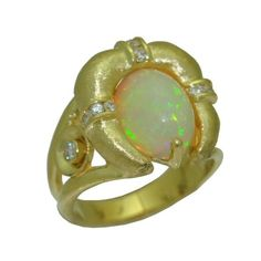Opal Ring with 0.38 Cttw. Diamonds https://www.goldinart.com/shop/rings/colored-gemstone-rings/opal-ring-with-0-38-cttw-diamonds #18KaratYellowGold, #OpalRing