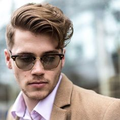 Messier side part with vintage style glasses. Nice combo.