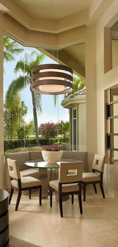 Beautiful Neutral Colored Dining Room. Amazing Windows makes it seem like the dining room is outdoors.